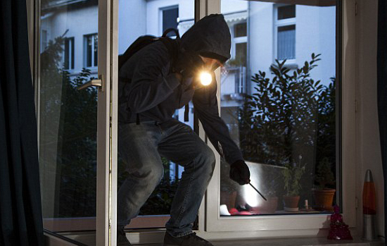 burglar breaking into home with no security