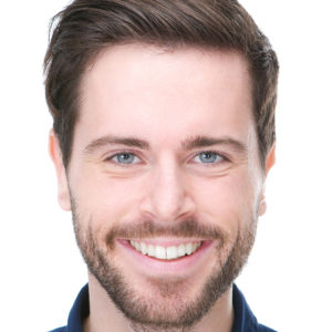 Closeup portrait of a happy male fashion model smiling on isolated white background